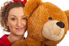 妇女的熊接近的女用连杉衬裤 图库摄影