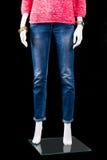 妇女的蓝色皮包骨头的适合牛仔裤 免版税库存图片