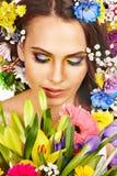 妇女的表面有花的。 免版税库存照片