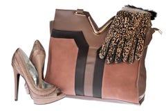 妇女的袋子、鞋子和手套 免版税库存照片