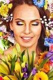 妇女的面孔有花的。 免版税库存照片