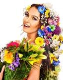妇女的面孔有花的。 免版税库存图片