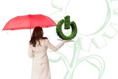 妇女的综合图象有伞的和草坪预定 库存照片
