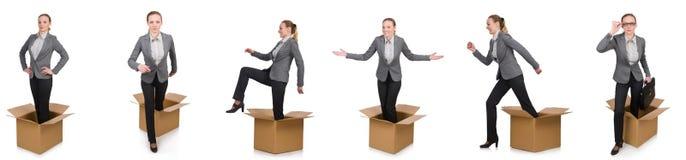 妇女的综合图象有箱子的在白色 库存图片
