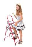 妇女的Pin与锤子和锯的梯子的 免版税库存照片