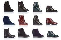 妇女穿上鞋子在白色背景的汇集,与光滑的表面上的一个阴影 正面图 12个片断 图库摄影