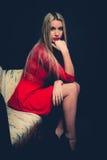 妇女红色礼服 免版税库存图片