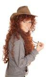 妇女红色头发帽子神色smle 库存照片