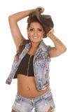 妇女纹身花刺女牛仔在面对的举行帽子 库存图片