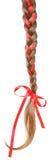 妇女编辫子用在白色隔绝的一把红色弓装饰。 库存照片