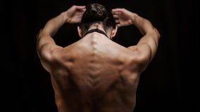 妇女舞蹈演员从后面在芭蕾姿势 免版税图库摄影
