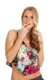 妇女花在嘴的礼服手指 图库摄影