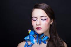 妇女蓝色蝴蝶 免版税库存图片