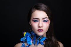 妇女蓝色蝴蝶 库存图片