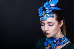 妇女蓝色蝴蝶 免版税图库摄影