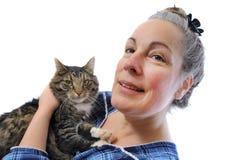 妇女藏品猫 免版税库存图片