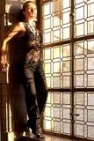 妇女被弄脏的窗口 免版税图库摄影