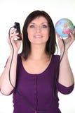 妇女被联络到世界 免版税图库摄影