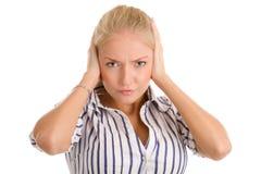 妇女覆盖物耳朵用手 免版税库存图片