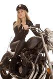 妇女警察摩托车乘驾神色 库存图片