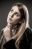 妇女认为 免版税图库摄影