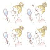 妇女调查手镜的,皮肤麻烦,护肤 库存图片