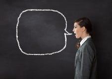 妇女谈的黑板 免版税库存照片