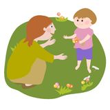 妇女谈话与一个小孩子 免版税库存图片