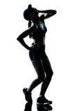 妇女赛跑者慢跑者疲乏气喘吁吁 免版税库存图片
