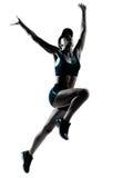 妇女赛跑者慢跑者跳 免版税库存照片