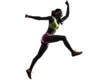 妇女赛跑者跑的跳跃的呼喊的剪影 免版税库存照片