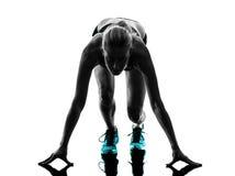 妇女赛跑者连续慢跑者跑步的剪影 库存图片