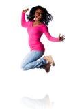 妇女跳跃幸福 免版税图库摄影