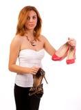 妇女辩论在鞋子 免版税图库摄影
