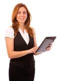 妇女运转的计算机或ipad 免版税库存图片
