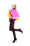 妇女运载的购物袋 免版税库存图片