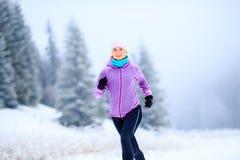 妇女连续启发和刺激,赛跑者 免版税库存图片