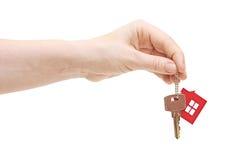 妇女递一个房子关键字 库存照片