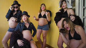 妇女重复的怀孕 JPG 库存图片