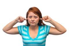 妇女闭合的耳朵 免版税库存照片