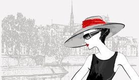 妇女附近的Ile de la在巴黎援引 免版税库存图片