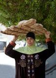 妇女面包卖主 库存照片
