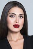 妇女面对与在嘴唇的施华洛世奇水晶 库存照片