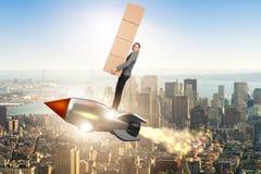 妇女飞行火箭和交付箱子 免版税库存图片
