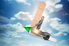 妇女飞行火箭和交付箱子 库存图片