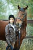 妇女骑师 免版税库存图片