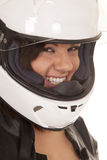 妇女骑自行车的人盔甲关闭笑 图库摄影