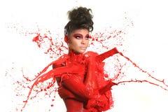 妇女高速摄影术有液体油漆的 免版税库存图片