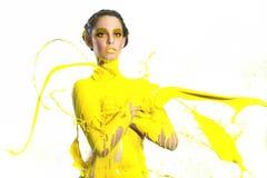 妇女高速摄影术有液体油漆的 免版税库存照片