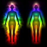妇女-剪影彩虹气氛  免版税库存照片